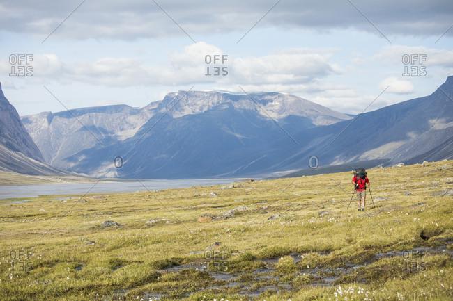 Backpacker hiking through open landscape.