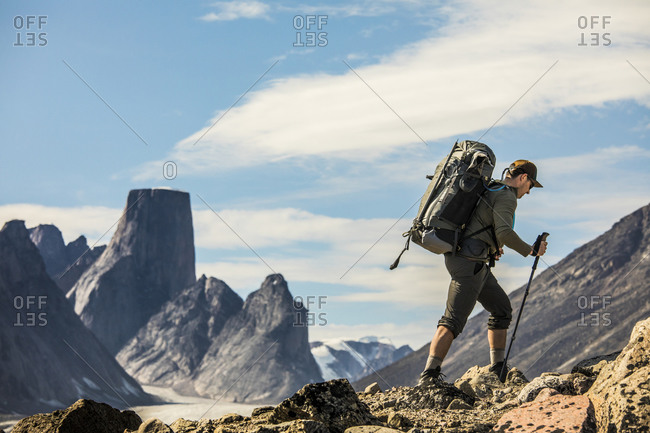 Backpacker on the move on rugged mountain ridge.