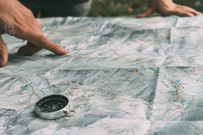 Planning the route on a map and a compass
