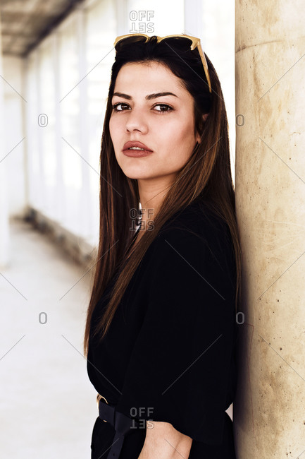 Portrait of a beautiful and fashionable young woman inside an abandoned building