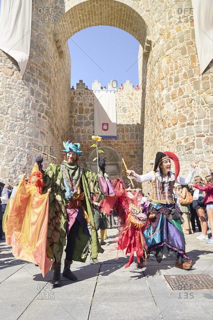 Avila, Spain - September 6, 2019: A medieval festival parade next to the wonderful wall of Avila.