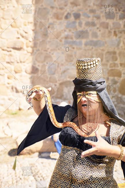 Avila, Spain - September 7, 2019: A medieval festival parade next to the wonderful wall of Avila.