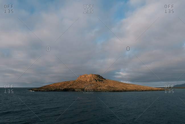 Sunrise on the conical hat shape of Sombrero Chino island in Galapagos
