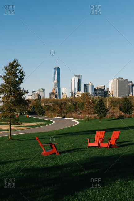 New York City skyline rises over lounge chairs on Governors Island