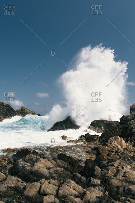 Powerful waves crash into the rocks along the Caribbean Atlantic coast
