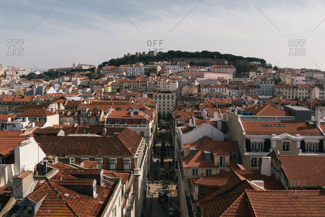 Lisbon, CT, United States - February 23, 2019: Red tiled roofs of the Lisbon skyline and Sao Jorge Castle