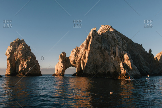 Cabo San Lucas, B.C.S., Mexico - January 11, 2018: A couple paddle boarders explore The Arch of Cabo San Lucas