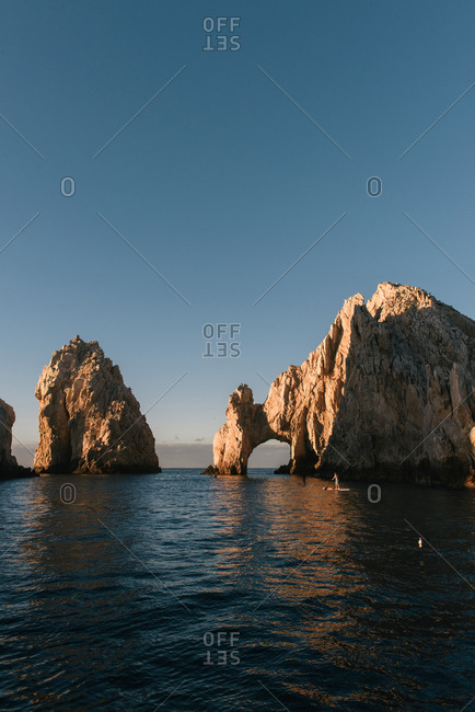 Paddle boarders out for morning exercise at The Arch of Cabo San Lucas