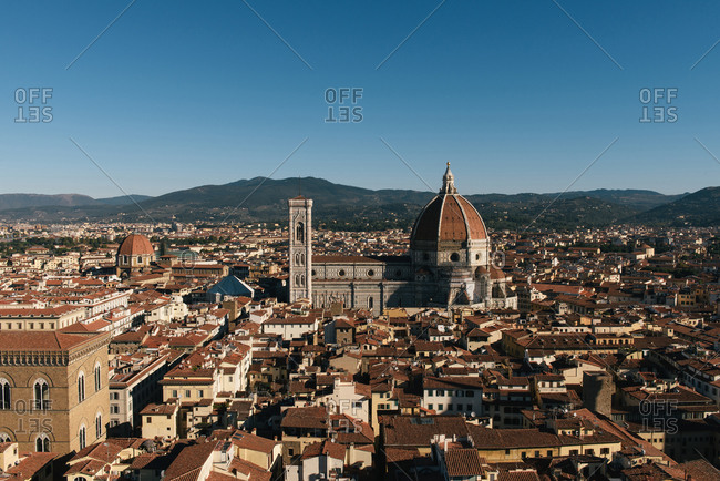 Florence, Tuscany, Italy - September 28, 2018: Direct view of the Florence Cathedral and red rooftops around