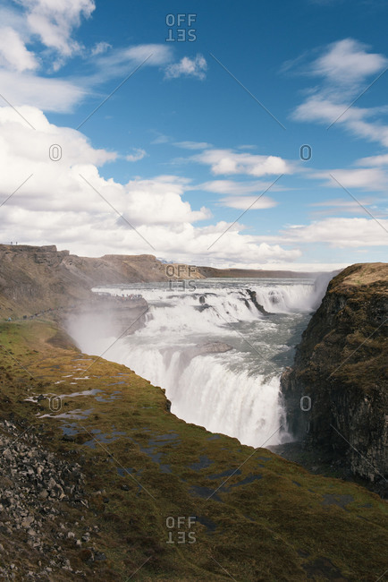 A crowd of tourists gather to watch the power of Gullfoss waterfall