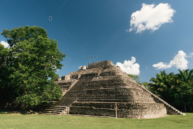 Chacchoben, Q.R., Mexico - July 3, 2016: A reconstructed Maya pyramid temple at the site of Chacchoben