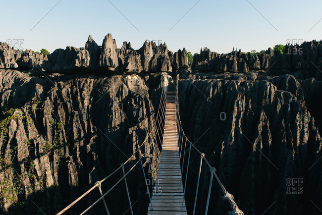 Crossing the rope suspension bridge above the Tsingy de Bemaraha