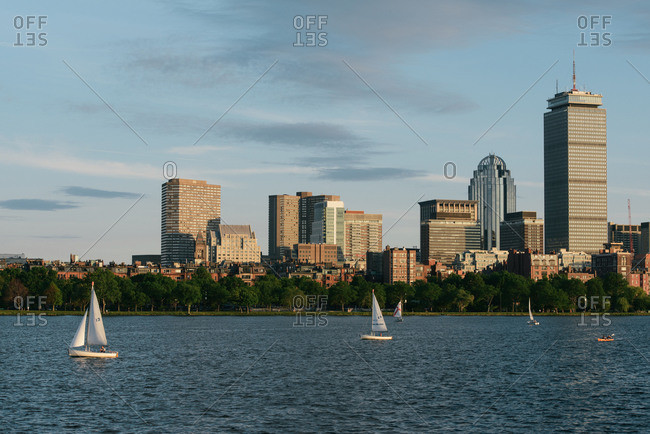 Boston, MA, United States - June 18, 2015: The Boston city skyline from across the Charles River with sailboats