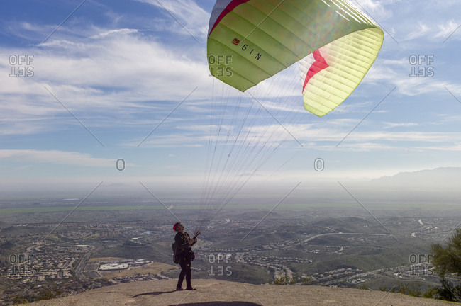 Phoenix, AZ, United States - January 11, 2020: Man tests lift from wind before jumping off to paraglide parachute