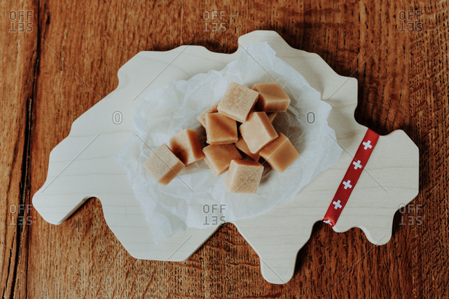 Swiss traditional milk caramel on the cutting board in the shape