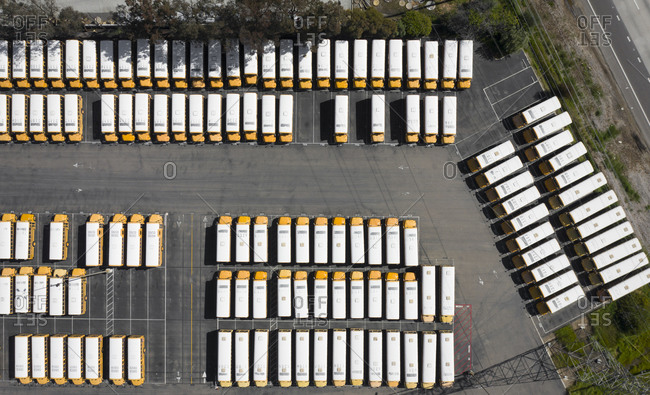 San Diego, CA, United States - April 16, 2020: A huge parking lot of orange school buses in San Diego