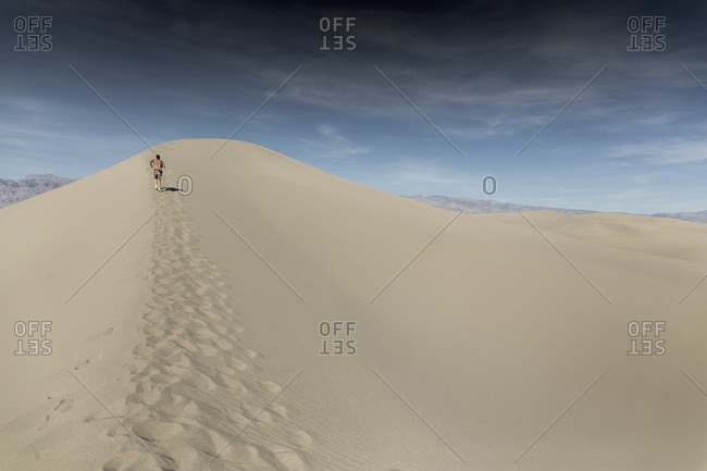 A man runs through the sand in Death Valley