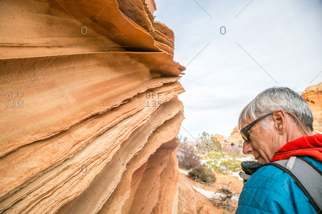 Man contemplates lace rock at South Coyote Buttes, Vermilion Cliffs