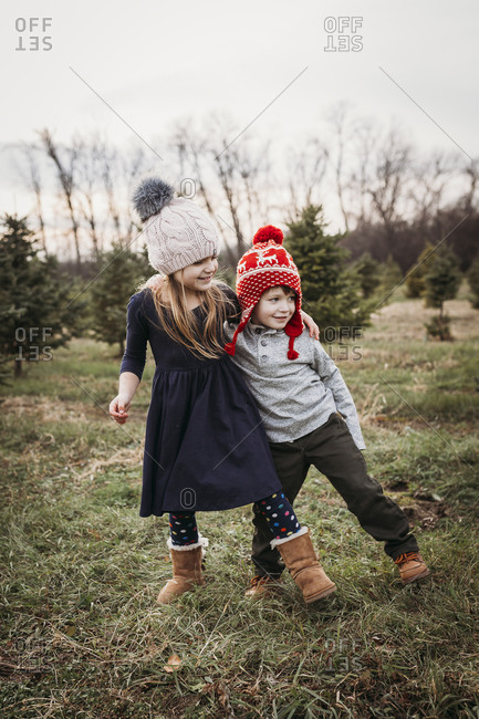 Boy and girl siblings at Christmas tree farm