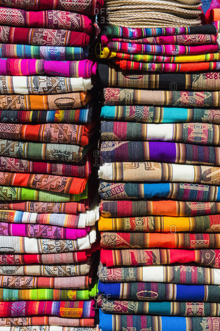 Colorful fabrics on market stall, San Pedro de Atacama