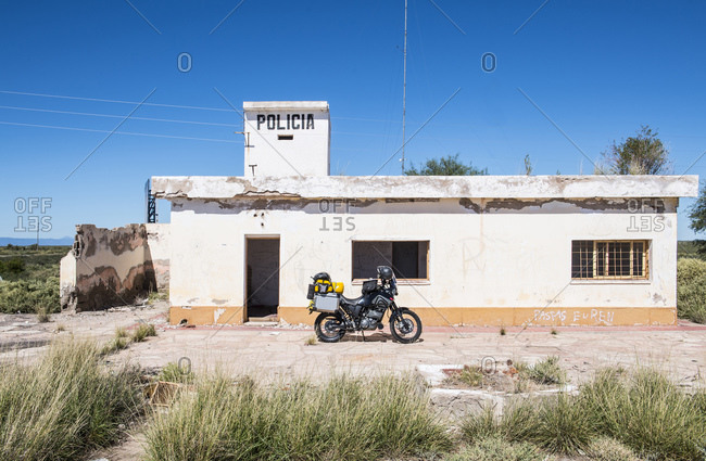 Mendoza, Mendoza Province, Argentina - April 11, 2017: Touring motorbike parked in front of abandoned police station