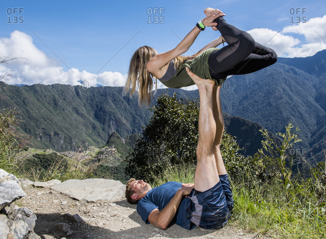 Couple practicing yoga on the Inca Trail close to Machu Picchu