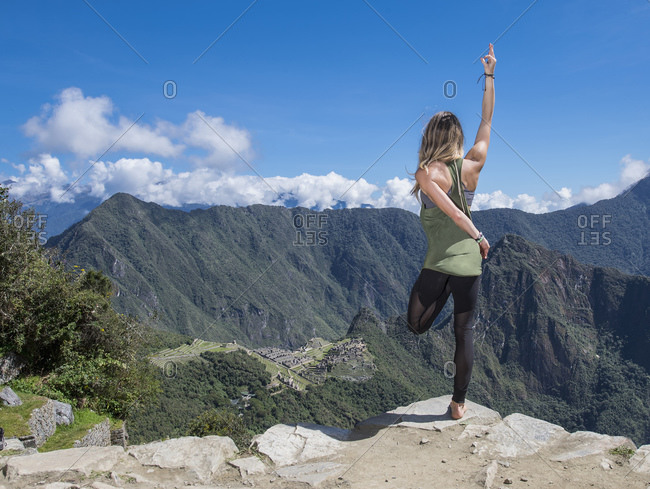 Woman practicing yoga on the Inca Trail close to Machu Picchu