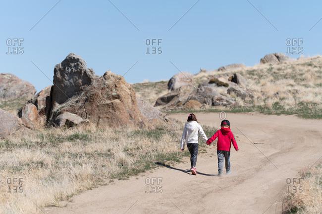 Children hiking on dirt road