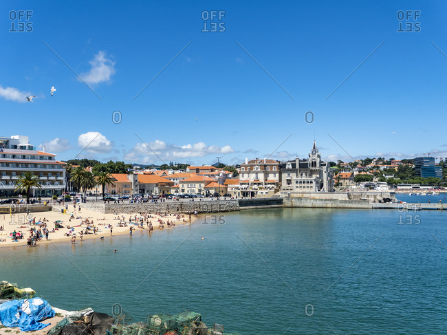 July 9, 2017: Portugal- Lisbon District- Cascais- People relaxing at Praia da Ribeira in summer