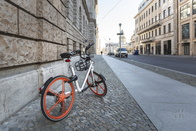 Germany- Berlin- Bicycle left on cobblestone sidewalk during COVID-19 epidemic