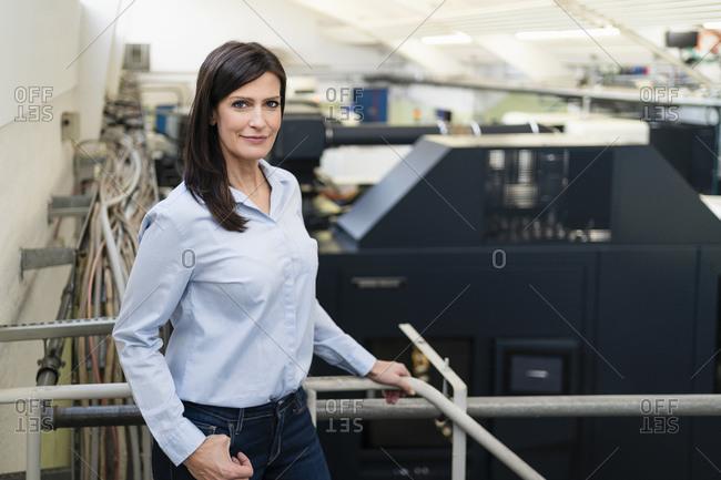 Portrait of a confident businesswoman in a factory