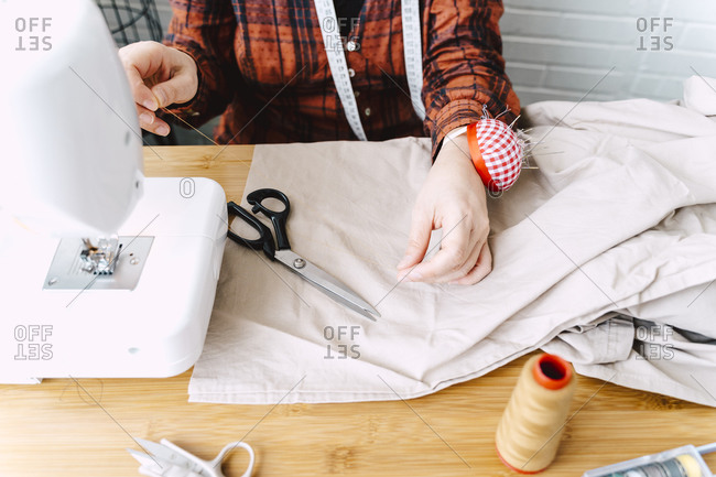 Close-up of woman sewing at home