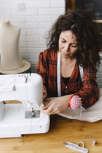 Woman sewing clothes at home