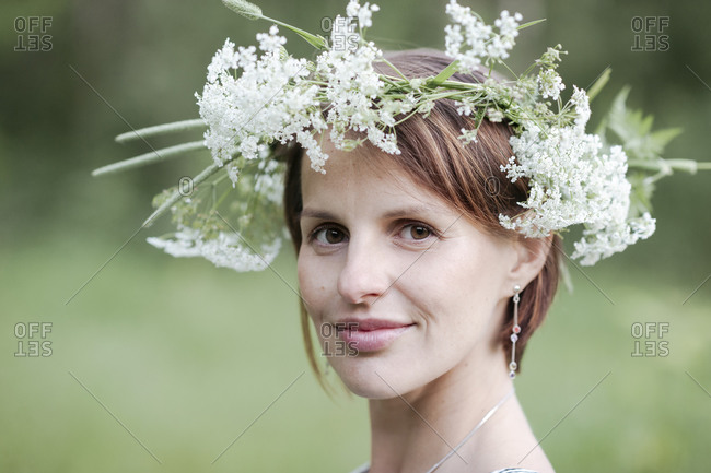 Close-up portrait of woman wearing white flowers