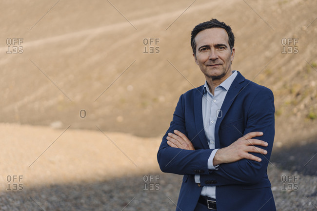 Portrait of a confident mature businessman on a disused mine tip