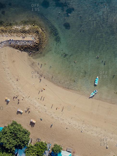 Indonesia- Bali- Sanur- Aerial view of people at sandy coastal beach
