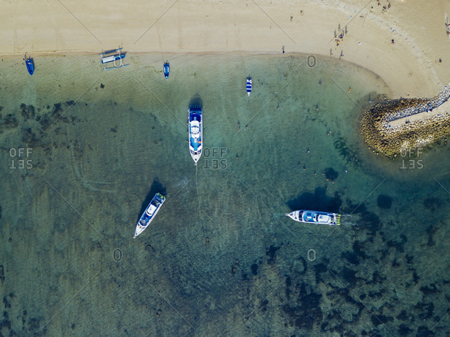 Indonesia- Bali- Sanur- Aerial view of boats moored in front of sandy coastal beach