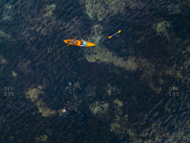 Indonesia- Bali- Sanur- Aerial view of two kayakers passing man fishing in shallow water