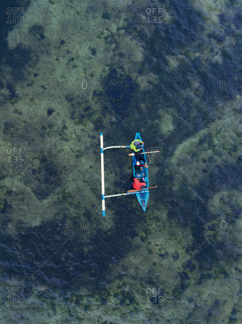 Indonesia- Bali- Sanur- Aerial view of two men fishing together on catamaran