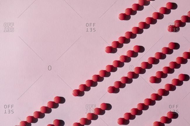 Studio shot of rows of red pills