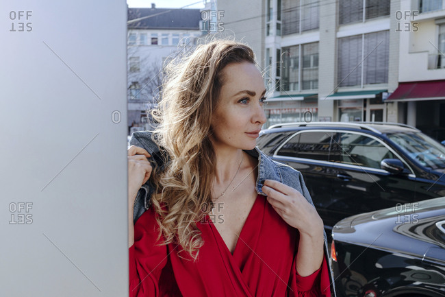Portrait of woman in red dress in the city