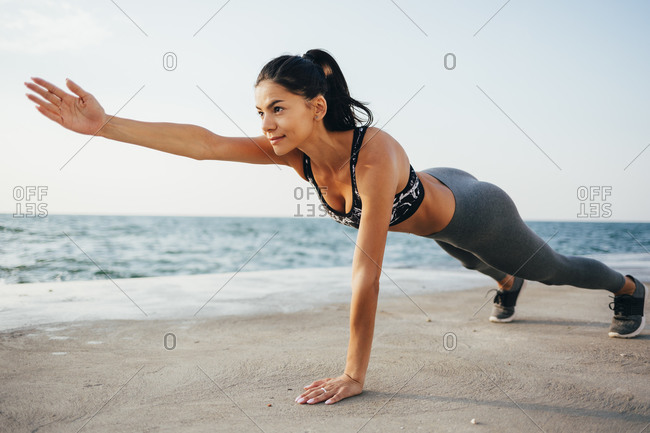 Determined young woman exercising on promenade