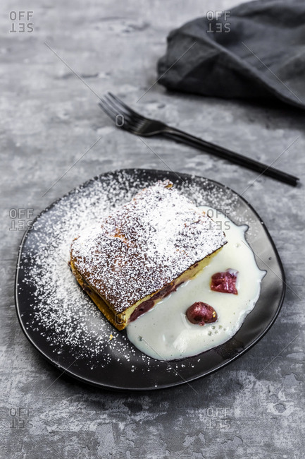 Slice of curd cheese casserole with cherries