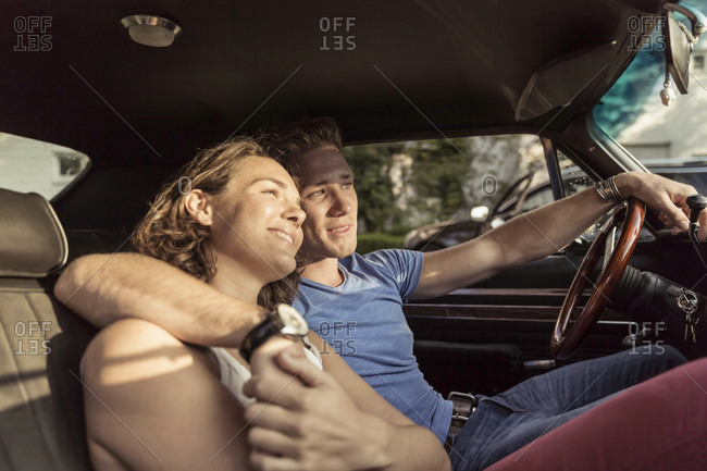 Couple in love relaxing in vintage car