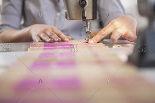 Close-up of seamstress at work