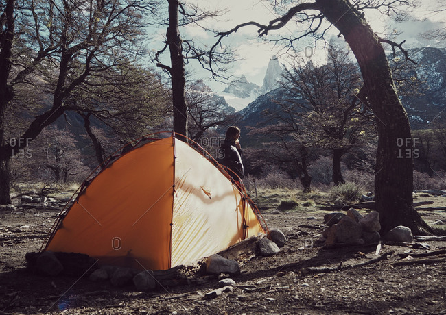 Woman camped in the forest with her camping tent- El Chalten- Argentina
