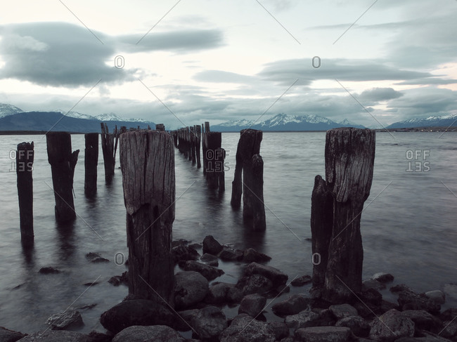 Wooden posts on sea against sky- Puerto Natales- Chile