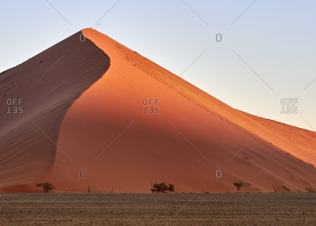 Sun shining on the red Dune 45- Sossusvlei- Namibia