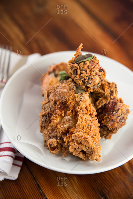 A close-up of a plate of fried chicken