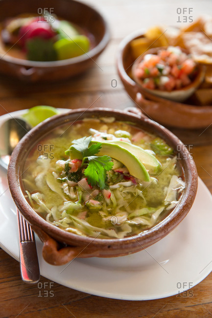 A bowl of steaming posole soup